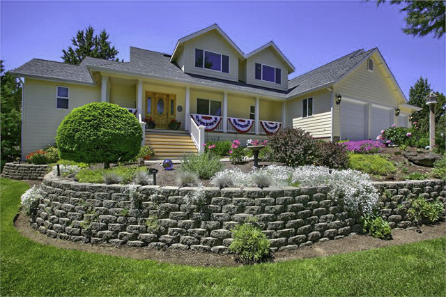 Beautifully landscaped 4 bedroom+office/3 bathroom home on 2.5 acres!
